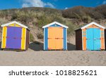 Colourful Beach Huts Next To...
