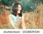 portrait of asian woman smiling ... | Shutterstock . vector #1018839334