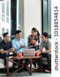 team of four dedicated... | Shutterstock . vector #1018854814