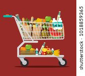 shopping cart with goods.... | Shutterstock .eps vector #1018859365