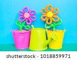 colorful plasticine flowers in...   Shutterstock . vector #1018859971