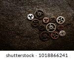 assorted metal gears on grunge... | Shutterstock . vector #1018866241