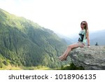 beautiful girl sitting on a... | Shutterstock . vector #1018906135