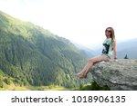 beautiful girl sitting on a... | Shutterstock . vector #1018906135