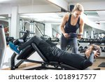handsome man doing sit ups on... | Shutterstock . vector #1018917577