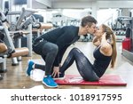 young sporty couple exercising... | Shutterstock . vector #1018917595