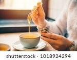 woman drink hot orange tea in... | Shutterstock . vector #1018924294