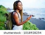 cheerful attractive tourist... | Shutterstock . vector #1018928254