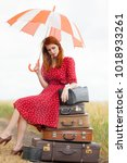 young redhead girl with... | Shutterstock . vector #1018933261