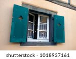 window with green shutters in... | Shutterstock . vector #1018937161