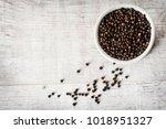 Black Pepper On White Wooden...