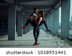 young sports couple exercising... | Shutterstock . vector #1018951441