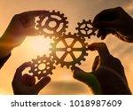 four hands of businessmen...   Shutterstock . vector #1018987609