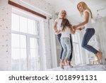 little girl  her attractive... | Shutterstock . vector #1018991131