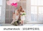 little cute girl  her... | Shutterstock . vector #1018992301