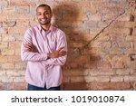 portrait of a happy handsome... | Shutterstock . vector #1019010874