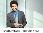 handsome businessman using a... | Shutterstock . vector #1019014261