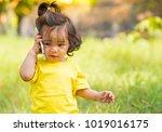 little girl listen and using... | Shutterstock . vector #1019016175
