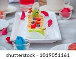 cake cut into pieces on the... | Shutterstock . vector #1019051161