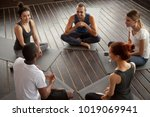 diverse smiling people sitting... | Shutterstock . vector #1019069941