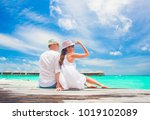 back view of couple sitting on... | Shutterstock . vector #1019102089