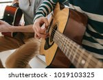 learning to play the guitar.... | Shutterstock . vector #1019103325