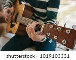 learning to play the guitar.... | Shutterstock . vector #1019103331