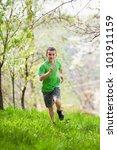 Boy Running In A Park Or Garde...