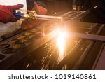 Small photo of Metal cutting with acetylene and oxygen gas torch. Soft focus due to high ISO and shallow Depth Of Field.