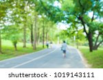 blurred sunny green park with... | Shutterstock . vector #1019143111