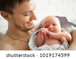 portrait of father with newborn ... | Shutterstock . vector #1019174599