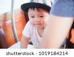 the asian boy in the wooden... | Shutterstock . vector #1019184214