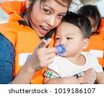 the asian baby with the mom in... | Shutterstock . vector #1019186107