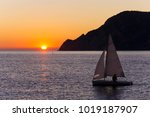 Sail Boat At Sunset On The Sea...