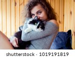 young curly woman in grey cloth ... | Shutterstock . vector #1019191819