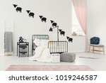 patterned pouf next to kid's... | Shutterstock . vector #1019246587