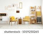 wooden stool between yellow... | Shutterstock . vector #1019250265