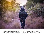 Small photo of The soldiers patrolled the jungle.