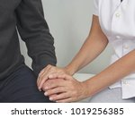 offering comfort to patient     ... | Shutterstock . vector #1019256385