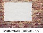 blank advertising poster glued... | Shutterstock . vector #1019318779