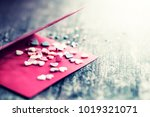 small hearts on the red card ... | Shutterstock . vector #1019321071