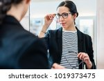 woman looking with glasses in... | Shutterstock . vector #1019373475