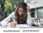 young woman concentrate reading ... | Shutterstock . vector #1019393437
