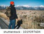 male traveler enjoying scenic... | Shutterstock . vector #1019397604