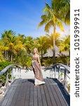 the beautiful woman in a long...   Shutterstock . vector #1019399911