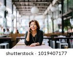 mature and attractive asian... | Shutterstock . vector #1019407177