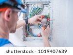 caucasian electric technician... | Shutterstock . vector #1019407639