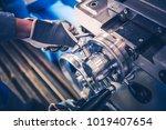 Metal Lathe Machine Operator Closeup Photo. Lathe Adjustment and Calibration. - stock photo