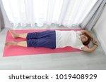 asian senior woman doing... | Shutterstock . vector #1019408929
