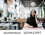 a young and attractive chinese... | Shutterstock . vector #1019412997